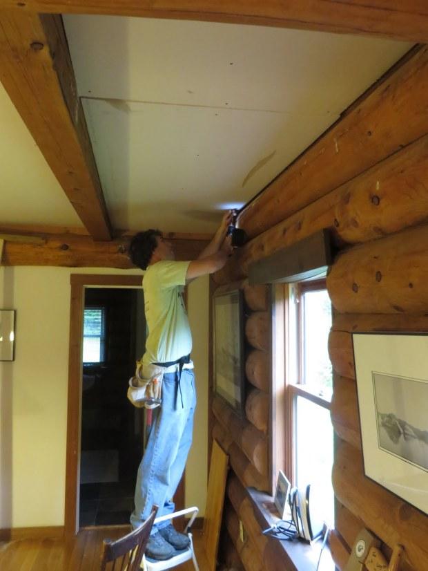Drilling the last few drywall screws.