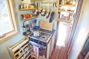Two-burner range and kitchen storage.