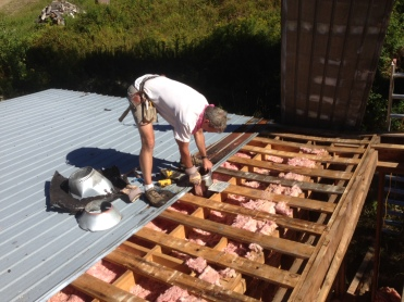 Corrugated roof removal.