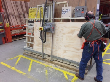 Ripping plywood at Home Depot.